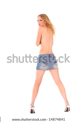 Back view of a topless blond woman wearing a short denim skirt, and high heels.