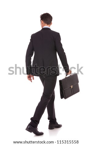back view of a walking business man holding a briefcase and looking to his side on white background