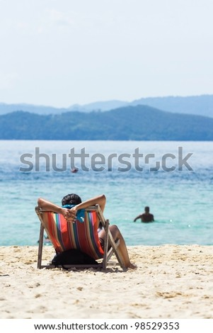 Back View of A Woman on a Beach Chair by the Sea