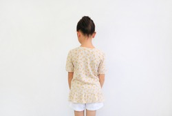 Back view of asian little child girl with bun hair up on white background isolated.