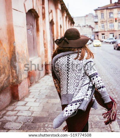 back view  of beautiful  fashionable woman in a hat