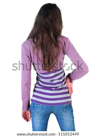 Back view of beautiful young woman looking at wall. Rear view.