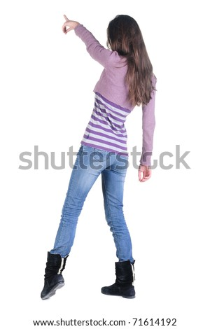 Back view of beautiful young woman pointing at wall. Rear view people series. Isolated over white background.