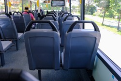 Back view of bus seats on double decker bus. Blank advertising space; for mockup display; bus seat sticker wrap. Empty bus.