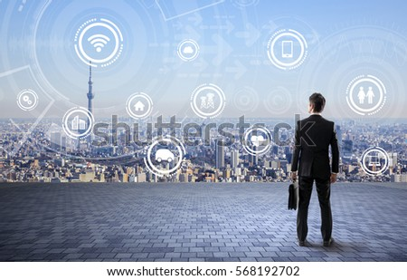 back view of business person and wireless communication network concept, Internet of Things, Smart City, Smart Grid, Information Communication Technology, abstract image visual #568192702