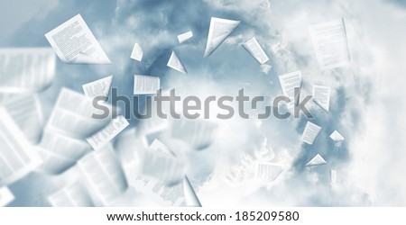 Back view of businessman reading documents in hand