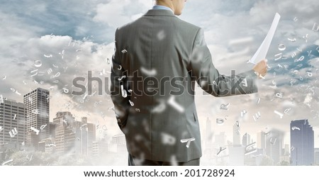 Back view of businessman reading documents in hand #201728924