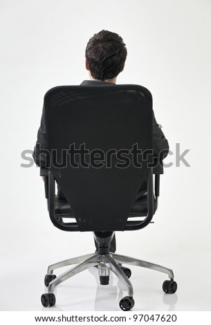 back view of businessman sitting at the chair