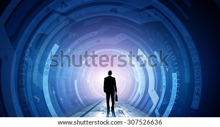 Back view of businessman with suitcase in hands looking at virtual panel