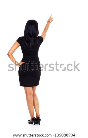 back view of businesswoman pointing up isolated on white