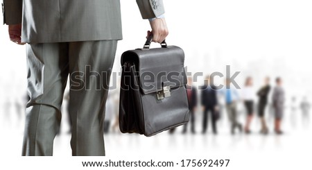 Back view of confident businessman with business team at background
