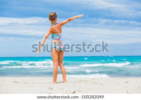 Back view of Cute teen girl relax ocean background