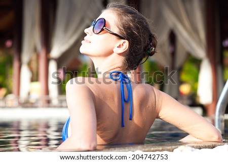 back view of fit woman in luxury spa pool