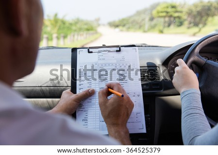 back view of girl taking driving test