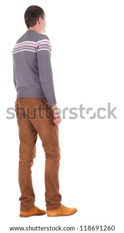 Back view of going  handsome man in jeans and sweater.  walking young guy in jeans and  jacket. Rear view people collection.  backside view of person.  Isolated over white background.
