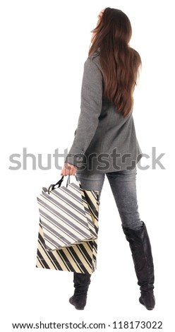 back view of going  woman  in  coat woman with shopping bags . beautiful brunette girl in motion.  backside view of person.  Rear view people collection. Isolated over white background.