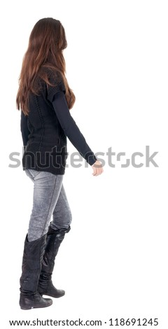back view of going  woman  in  in jeans and sweater. beauty brunette girl in motion.  backside view of person.  Rear view people collection. Isolated over white background. - stock photo
