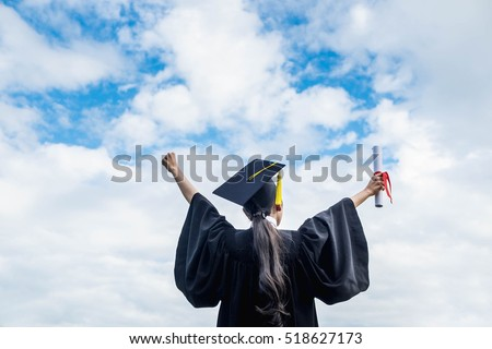 back view of graduate student girl hug future and look up to copy space, she wear graduation cap and gown ,asian woman