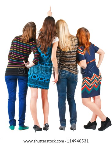 Back view of group beautiful women pointing at wall. Girls team Girl friends looks into the distance. Rear view people. Isolated over white background.