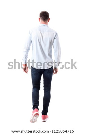 Back view of handsome elegant business man in sneakers walking away and looking ahead. Full body isolated on white background. #1125054716