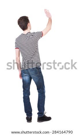 Back view of handsome man greeting waving from his hands. Standing young guy in jeans. Rear view people collection.  backside view of person.  Isolated over white background. Curly French waves. #284164790