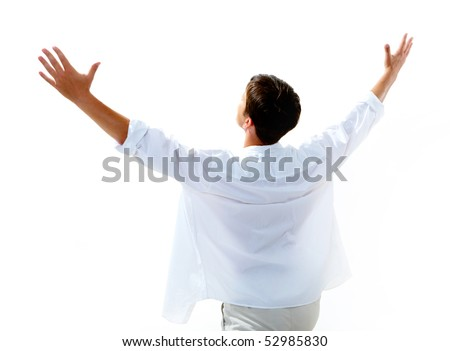 Back view of happy young man raising his arms enjoying life