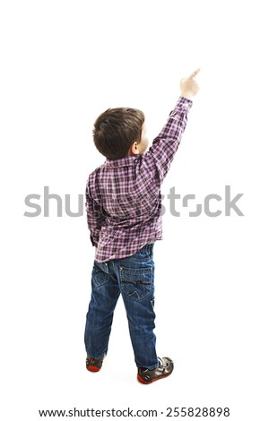 Back view of little boy points at wall. Rear view. Isolated on white background  #255828898