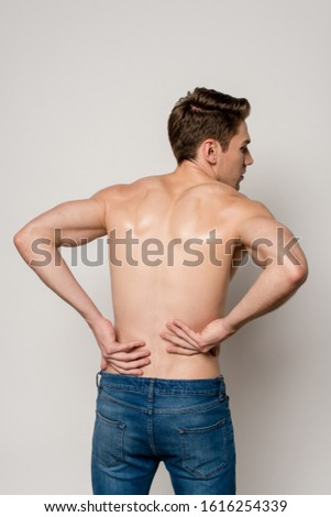 back view of man having backache isolated on grey