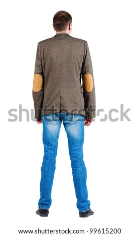 Back view of men in jacket suit and jeans. Guy looks at wall. Rear view. Isolated over white background
