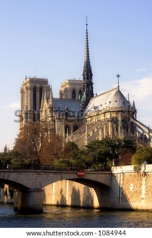 Back view of Notre-Dame cathedral slightly before dusk - Paris, France