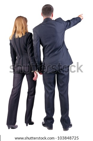Back view of pointing business team. young couple (man and woman) . beautiful girl and guy in suit together. Rear view people collection. backside view of person. Isolated over white background