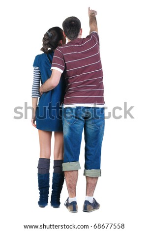 Back view of pointing young couple . Rear view. Isolated over white.