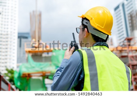 back view of professional engineer asian male safety helmet manage control constuction site with expertise working #1492840463