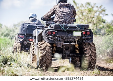 Back view of quad bike  zipping along a country road. Stock photo ©