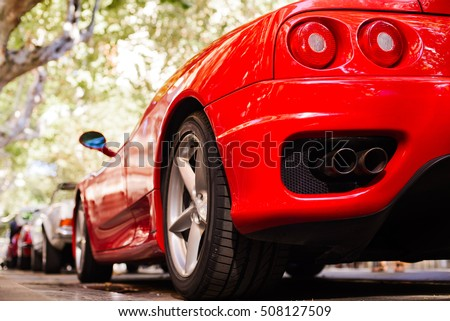 "stock photo back view of red ferrari exhaust and headlights 508127509 - Каталог - Фотообои ""Автомобили"""