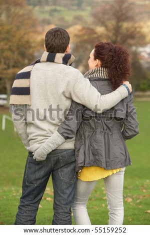 Back View Of Romantic Teenage Couple In Autumn Landscape