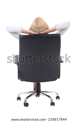 back view of satisfied business woman  with hands crossed behind her head sitting on office chair isolated on white background