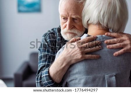 back view of senior woman hugged by husband, sick on dementia Сток-фото ©