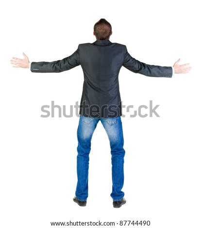 Back view of shocked and scared young business man. Holds hands upwards. Rear view. Isolated over white background.