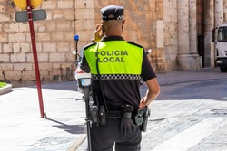 Back view of Spanish municipal police  with
