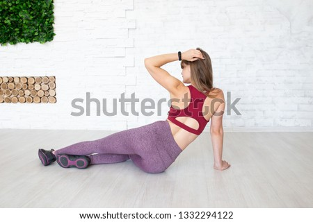 Back view of sporty woman. Sporty woman in sport style clothes on floor