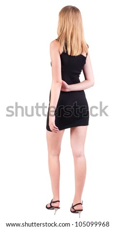 back view of standing beautiful blonde business woman . Young girl in black dress .  Rear view people collection.  backside view of person.  Isolated over white background.