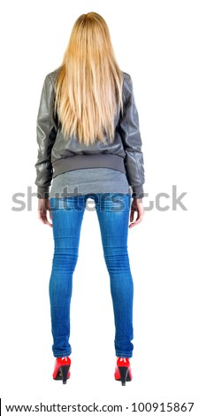 back view of standing beautiful blonde woman. Young girl in jacket, jeans and red kitten heels. Rear view people collection.  backside view of person.  Isolated over white background