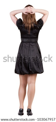 back view of standing beautiful   woman. Young blonde girl in black dress and  kitten heels. backside view of person.  Rear view people collection. Isolated over white background.