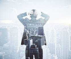 Back view of stressed businessman on city background. Employment concept. Double exposure