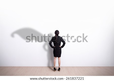 Back view of Superhero business woman look white wall background, great for your design or text, asian