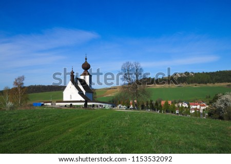 Back view of the church in Žehra and the travertine formation of Dreveník in early spring #1153532092