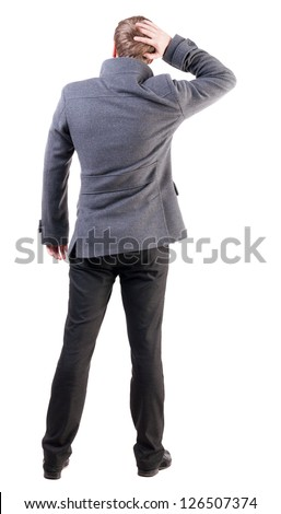 Back view of thinking business man in coat. gesticulating adult businessman  .  backside view of person.  Isolated over white background. Rear view people collection.