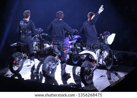 Back view of three motorcross racers /winners on stage #1356268475