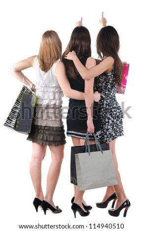Back view of three woman with shopping bag.Rear view people collection.  backside view of person.  Isolated over white background. - stock photo